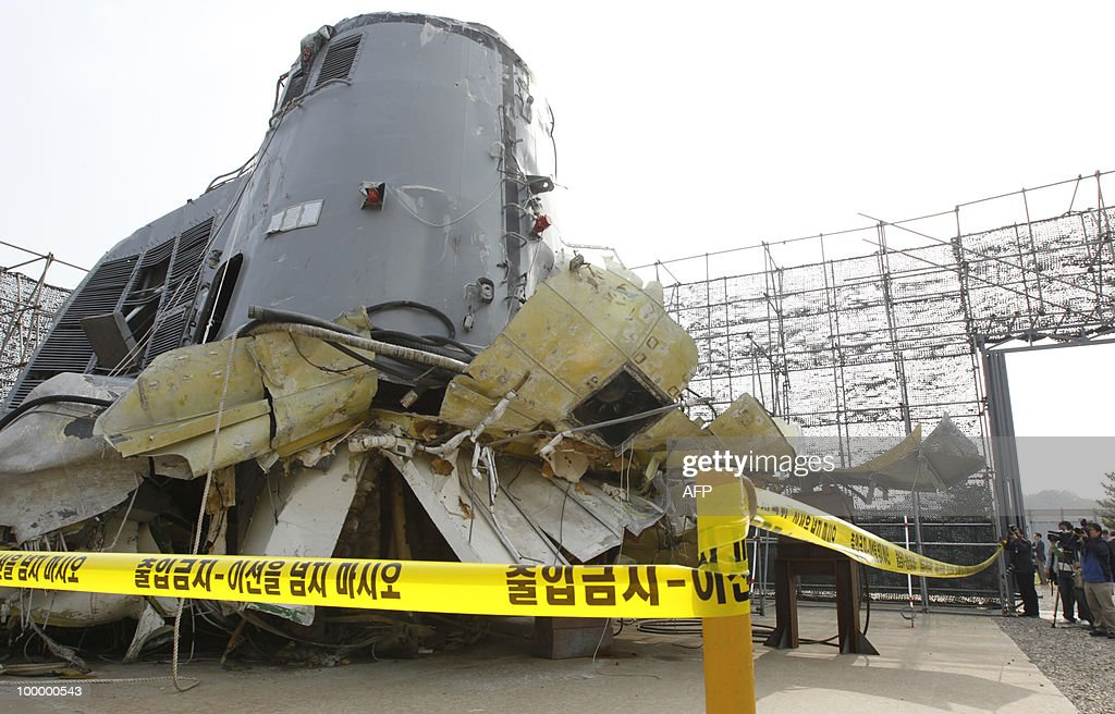 In a picture taken on May 19, 2010, Photographers take pictures of the salvaged South Korean naval vessel Cheonan, which sank on March 26 near the maritime border with North Korea, during a media briefing at the Second Fleet Command of Navy in Pyeongtaek, south of Seoul. A torpedo fired by a North Korean submarine sank a South Korean warship with the loss of 46 lives, investigators said on May 20, 2010.