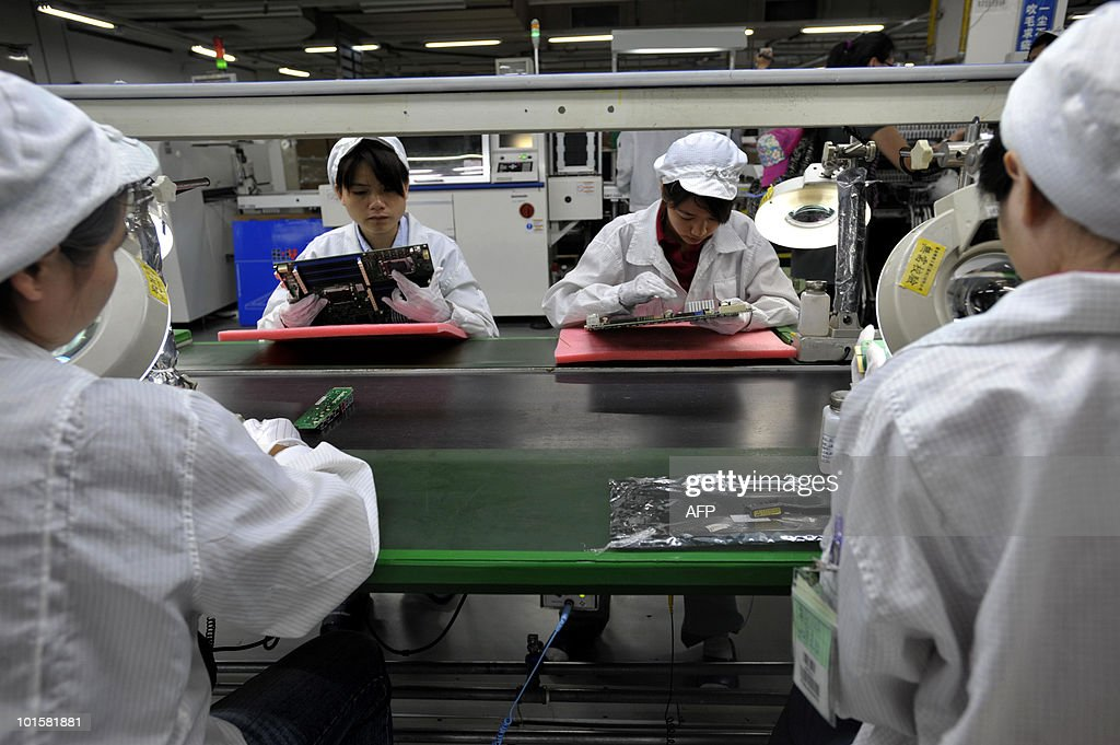 In a picture taken on May 26, 2010 Chinese workers assemble electronic components at the Taiwanese technology giant Foxconn's factory in Shenzhen, in the southern Guangzhou province. Foxconn on June 2 confirmed the death of another employee but denied he died of exhaustion following a spate of suicides at its Chinese plants. CHINA