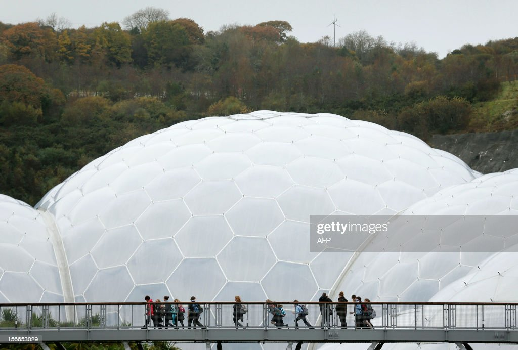 In a picture taken on November 12, 2012 children walk along a footbridge in front of one of the biomes at the Eden Project in St Austell, Cornwall, southwest England. The tropical tranquility beneath the Eden Project's striking domes, paid for with EU cash, is a sweet-scented haven from the bitter political row over the bloc's budget. Largely funded by European Union money It is hoping for further cash from the EU's 2014 to 2020 budget period to invest in its new HOW2 exhibition space, showcasing sustainable technologies. That budget has yet to be agreed however, and will be the subject of a bitter fight between EU leaders when they meet in Brussels next week.