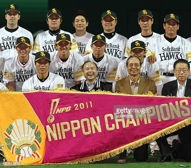 In a picture taken on November 20 Pacific League champions Softbank Hawks manager Koji Akiyama owner Masayoshi Son and chairman Sadaharu Oh smile...