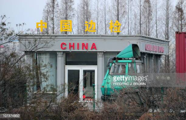 In a picture taken on November 26 2010 a container truck passes a Chinese checkpoint crossing over from Siniuju in North Korea on the SinoKorean...