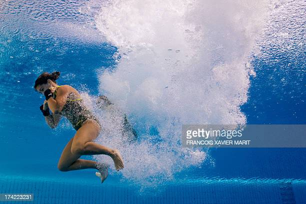 In a picture taken with an underwater camera Australia's Lara Tarvit and Emily Boyd enter the water after a dive in the women's 10metre synchro...