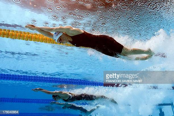 In a picture taken with an underwater camera France's Camille Muffat and Russia's Veronika Popova compete in the heats of the women's 200metre...