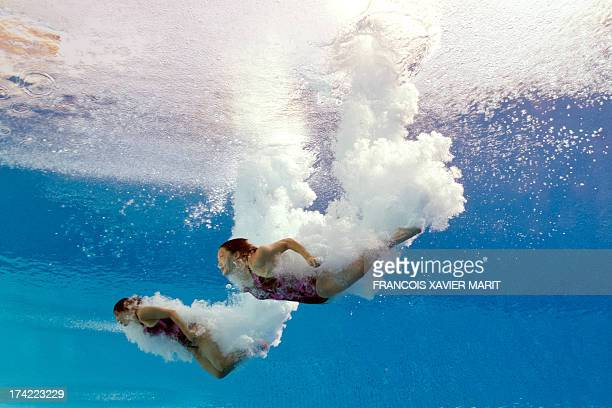 In a picture taken with an underwater camera South Korea's Kim Suji and Cho Eunbi enter the water after a dive in the women's 10metre synchro...