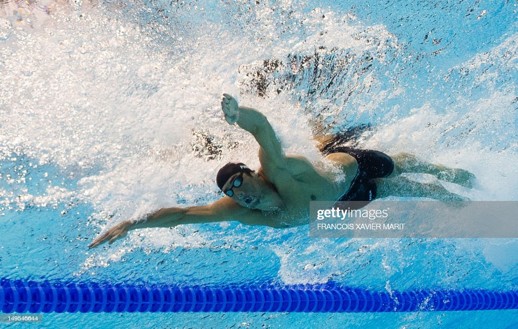 in a picture taken with an underwater camera us swimmer michael phelps competes in the mens