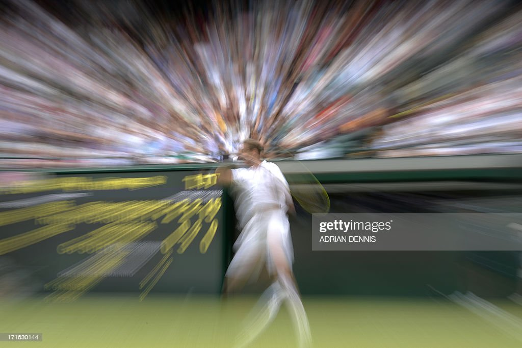 In a picture using a slow shutter speed and zoom-burst effect France's Richard Gasquet returns against Japan's Go Soeda during their second round men's singles match on day four of the 2013 Wimbledon Championships tennis tournament at the All England Club in Wimbledon, southwest London, on June 27, 2013.