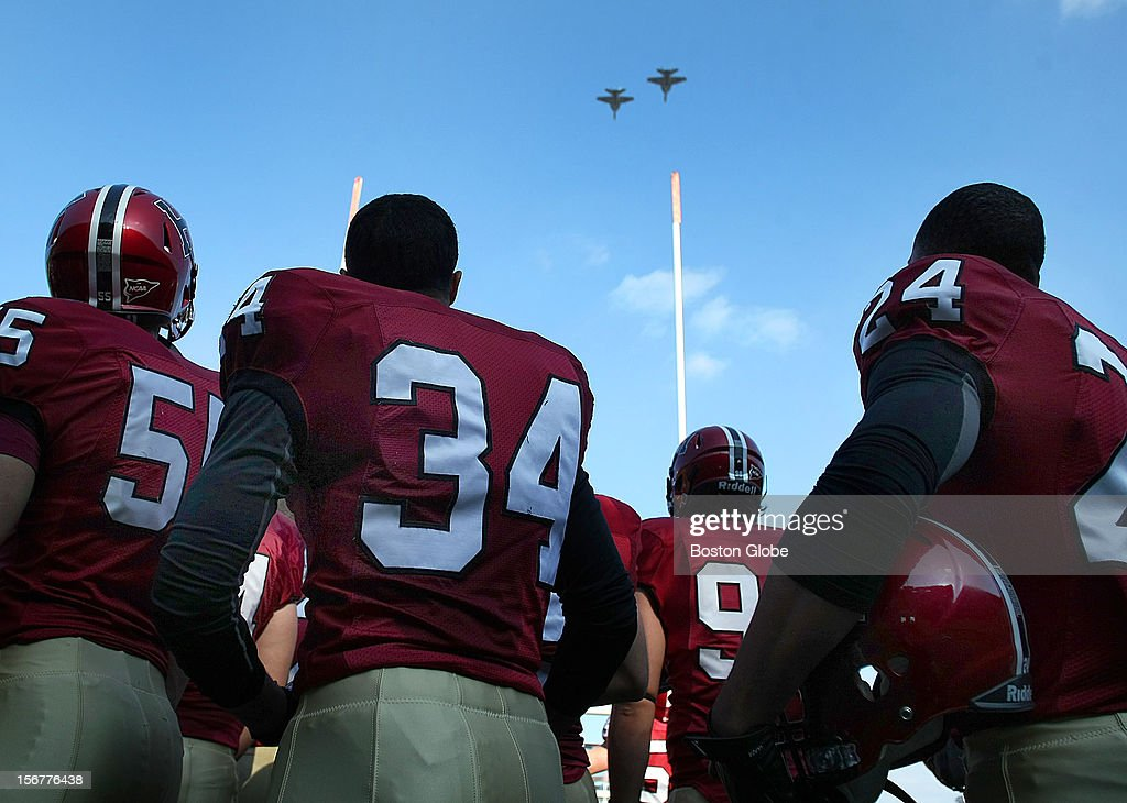 In a pre-game ceremony, fighter jets fly over the Stadium as Harvard players look on before Harvard University hosts Yale University during their annual game, Nov. 17, 2012 at Harvard Stadium.