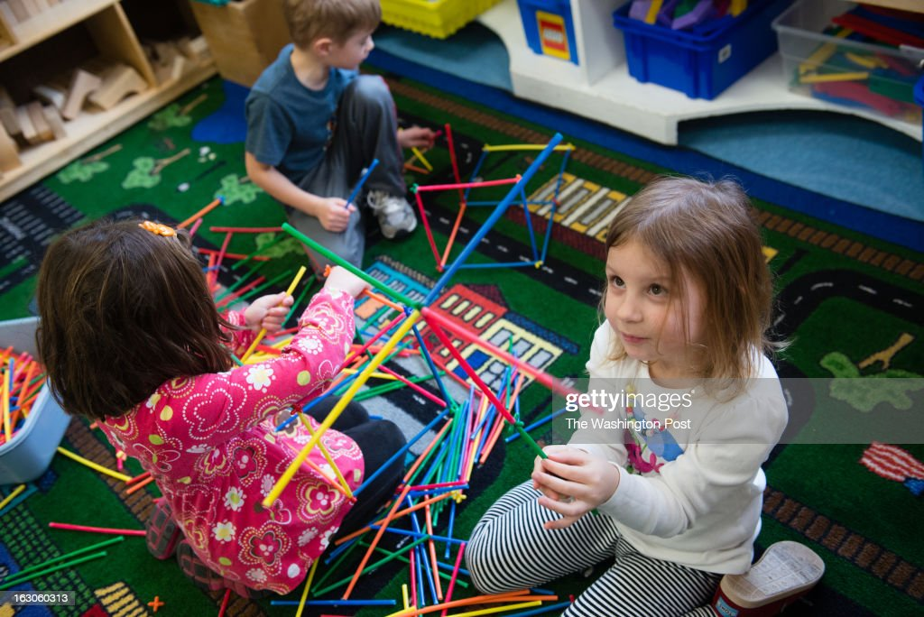 In a Pre-K class, Anna Krotky-Koeppe, 4, right, builds with straws. On the left are Connor Gawronski, 5, and Willie Brooke, 5. The straws teach fine motor skills, teamwork, and expressive language skills. At the St. Andrews Episcopal School in Potomac, MD, they use brain research to inform teaching and learning. The school has the only K-12 school center for teaching based on brain research in the country.
