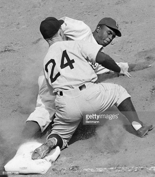 In a preseason game at Ebbets Field New York Yankee third baseman Bill Johnson tags out Jackie Robinson of the Brooklyn Dodgers as Robinson tried to...