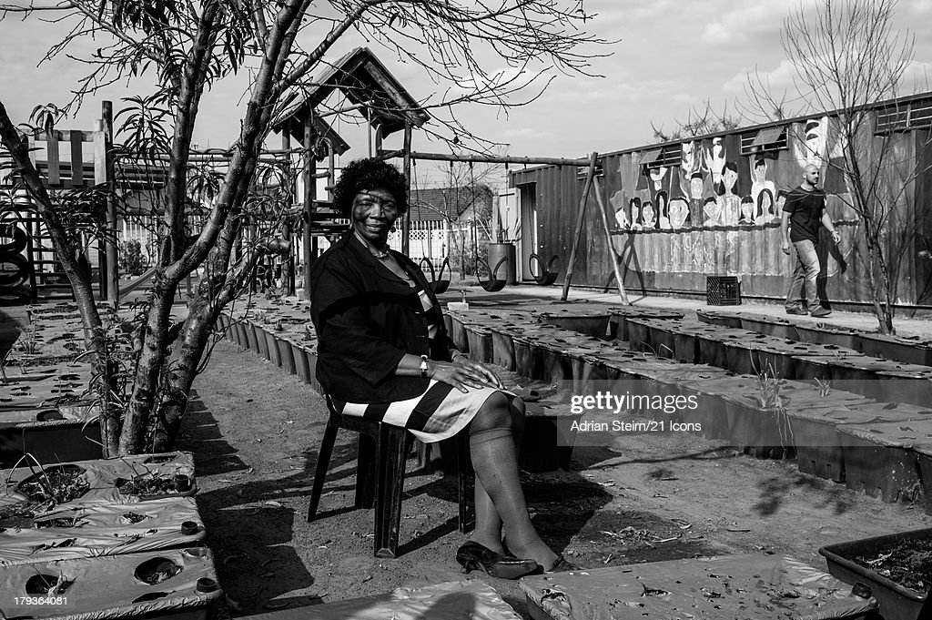 In a previously unreleased photograph series of Dr Lillian Cingo being photographed by Adrian Steirn, Lillian poses at the Noah Community Centre on June 20, 2012 at Kliptown, Soweto, South Africa as part of photographer and filmmaker Adrian Steirn's 21 Icons South Africa Series. Inspired by Nelson Mandela, 21 Icons is a series of short films and photographic portraits documenting the stories of key figures in South Africa's recent history including Nelson Mandela and Archbishop Emeritus Desmond Tutu. Proceeds from the syndication of this portrait will be donated to the Phelophepa I and II health care trains.