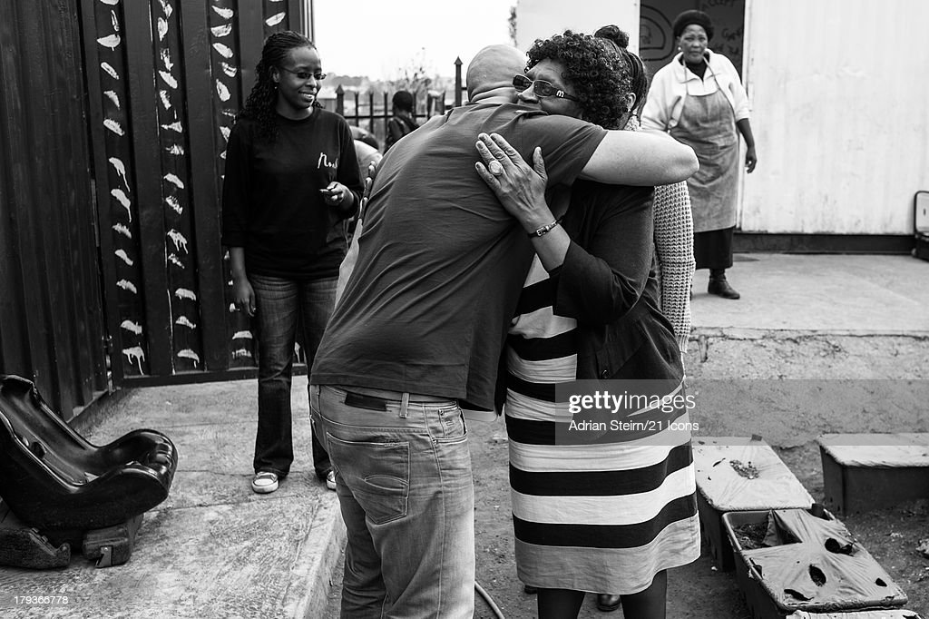 In a previously unreleased photograph series of Dr Lillian Cingo being photographed by Adrian Steirn, Lillian hugs Adrian after the shoot at the Noah Community Centreon June 20, 2012 at Kliptown, Soweto, South Africa as part of photographer and filmmaker Adrian Steirn's 21 Icons South Africa Series. Inspired by Nelson Mandela, 21 Icons is a series of short films and photographic portraits documenting the stories of key figures in South Africa's recent history including Nelson Mandela and Archbishop Emeritus Desmond Tutu. Proceeds from the syndication of this portrait will be donated to the Phelophepa I and II health care trains.