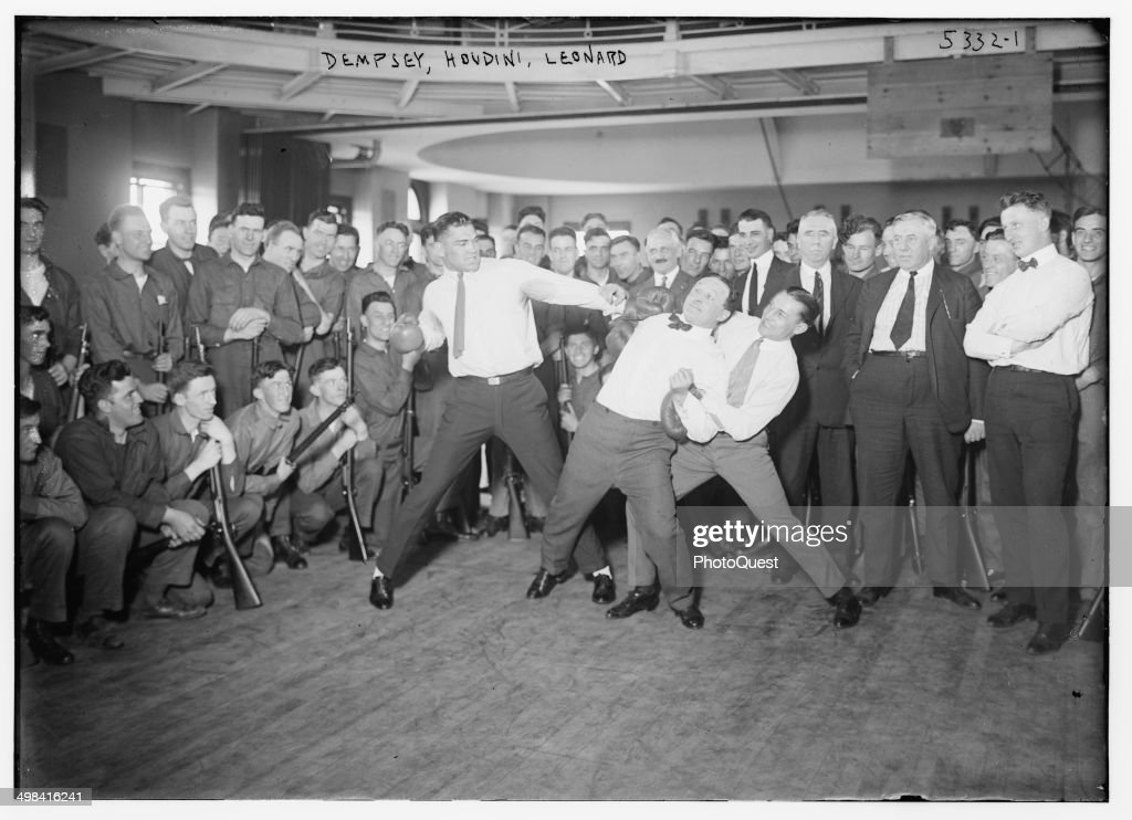 In a publicity photo, boxer <a gi-track='captionPersonalityLinkClicked' href=/galleries/search?phrase=Jack+Dempsey+-+Boxer&family=editorial&specificpeople=15348667 ng-click='$event.stopPropagation()'>Jack Dempsey</a>, magician <a gi-track='captionPersonalityLinkClicked' href=/galleries/search?phrase=Harry+Houdini&family=editorial&specificpeople=91037 ng-click='$event.stopPropagation()'>Harry Houdini</a>, and Benny Leonard stage a mock fight for soldiers, 1920s.