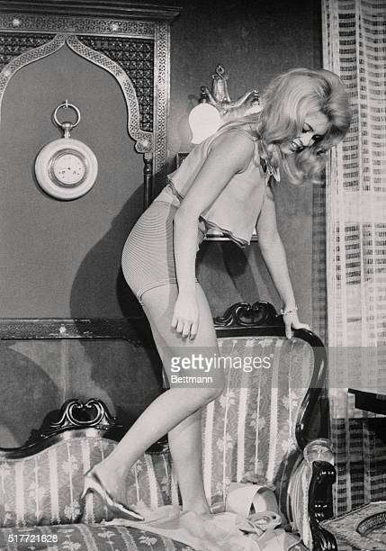 In a scene from her new movie Adorable Fool Brigitte Bardot appears to use a divan for a striptease stage The French 'sex kitten' who became famous...