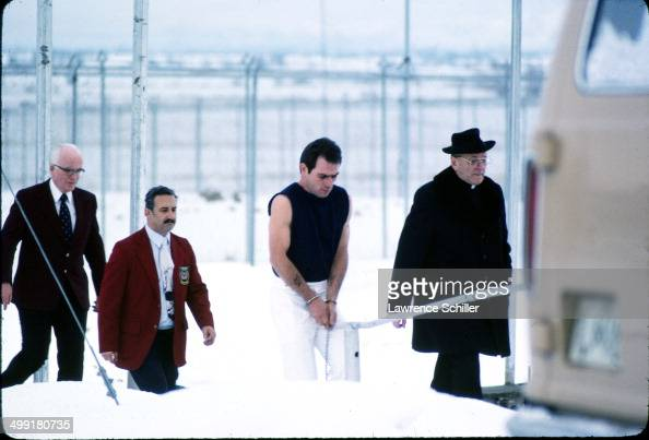 In a scene from the madefortelevision movie 'The Executioner's Song' American actor Tommy Lee Jones walks behind Reverend Thomas J Meersman Provo...