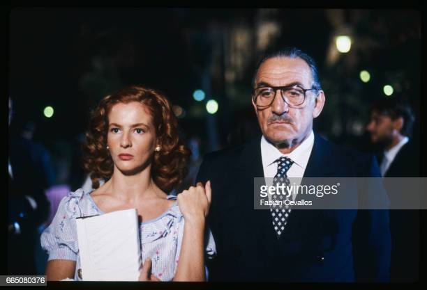 In a scene from the movie 'Cento Giorni a Palermo' directed by Giuseppe Ferrara actor Lino Ventura wearing glasses a dark suit a shirt and a tie...