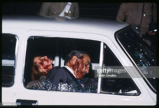 In a scene from the movie 'Cento Giorni a Palermo' directed by Giuseppe Ferrara actors Lino Ventura and Giuliana De Sio sit dead in the car where...