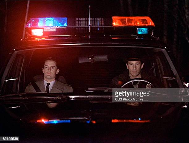 In a scene from the pilot episode Kyle MacLachlan as Special Agent Dale Cooper sits with Michael Ontkean as Sheriff Harry S Truman as they...