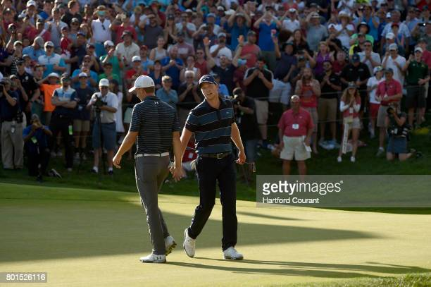 In a show of sportsmanship Daniel Berger lowfives Jordan Spieth after Spieth holed a 61 foot bunker shot on the first play hole during the final...