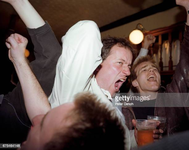 In a south London pub England football fans celebrate a goal during a World Cup qualifier against Sweden March 2001