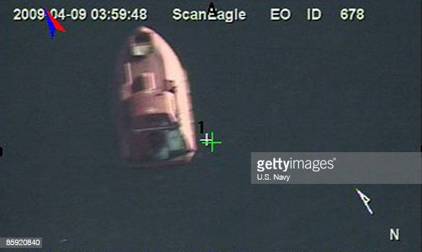 In a still frame from video released by the US Navy taken by the Scan Eagle unmanned aerial vehicle a 28foot lifeboat from the USflagged container...
