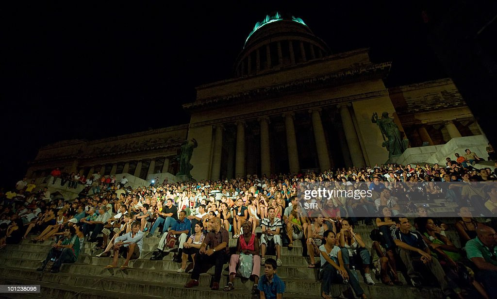In a street of Havana, Cubans observe to UK's Royal Ballet and National Ballet during a special presentation on July 15, 2009 in Havana.