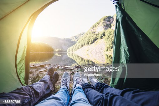In A Tent Near The Lake With Friends