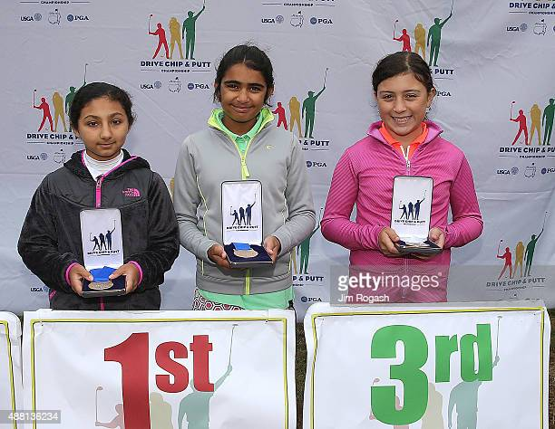In a tie for first place Srishti Dhurandhar and Shivani Dora pose with third place winner Sydney Hidalgo in the Girls 1011 Driving Competition pose...