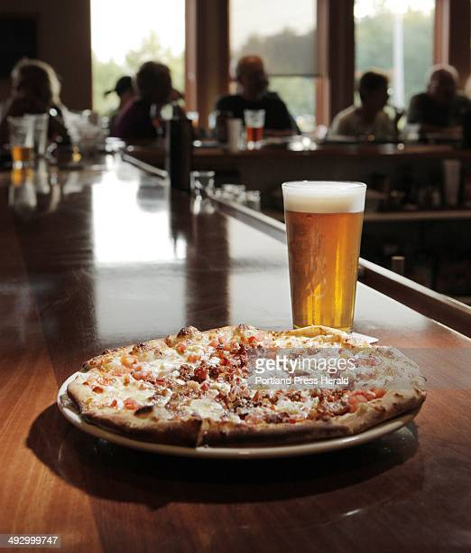 In addition to its wide selection of beer including a Frye's Leap IPA pictured here Sebago Brew Pub in Kennebunk has flatbread pizzas made with a...