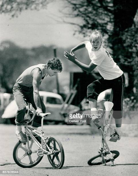 In an alley just west of South Santa Fe BMX rides do some tricks left Max Condiotti 18 right Roger Bradley 16 Both are members of the Mile Hi...