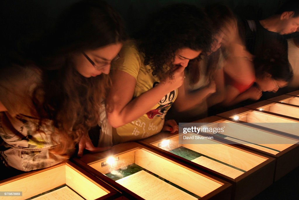 In an almost pitch-dark room, Israeli students inspect Albert Einstein's General Theory of Relativity on display in its entirety for the first time, at the Israeli Academy of Sciences and Humanities on March 9, 2010 in Jerusalem, Israel. Einstein donated the complete original forty-six page handwritten manuscript of his ground-breaking theory to The Hebrew University of Jerusalem during its inauguration in 1925.