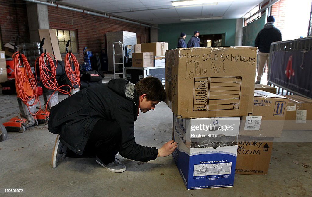 In an area of Fenway Park used for player parking and storage, office administration worker TJ Warwick labels boxes. The Red Sox equipment truck gets packed and leaves Boston for Florida, on Tuesday, Feb. 5, 2013.