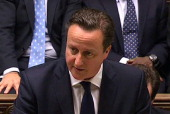 In an image grab from pooled video footage taken on January 18 2013 shows British Prime Minister David Cameron giving the parliament in London an...