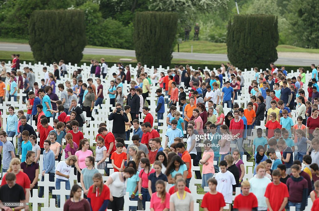 In an orchestrated event children walk among crosses at the Douaumont cemetery during ceremonies to commemorate the 100th anniversary of the World War I Battle of Verdun on May 29, 2016 near Verdun, France. The 1916, 10-month battle pitted the French and German armies against one another in a grueling campaign of trench warfare and artillery bombardments that killed a total of approximately 300,000 soldiers. The events today coincide with the 50th anniversary of commemorations held at Verdun by then French President Charles de Gaulle and German Chancellor Konrad Adenauer that paved the way for a new era of peaceful, post-war Franco-German relations.