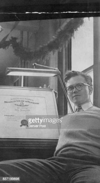 In appreciation for his cartoon entitled 'Psychological Handicap' John Somerville Denver Post staff cartoonist was recently given a certificate of...