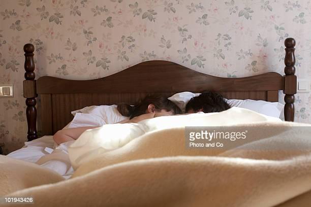 in bed in hotel room