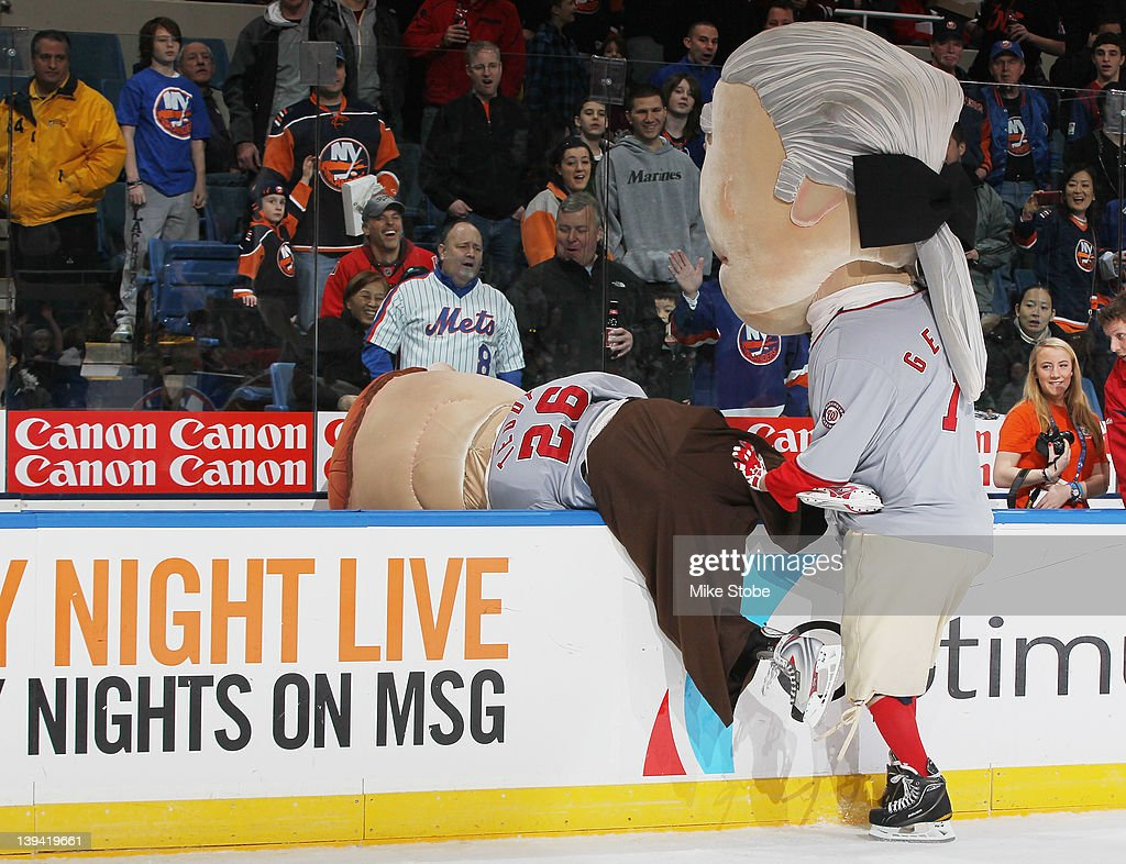 In celebration of President's Day, the Washington Nationals' mascots George Washington and Teddy Roosevelt participate in a race during intermission at Nassau Veterans Memorial Coliseum on February 20, 2012 in Uniondale, New York.