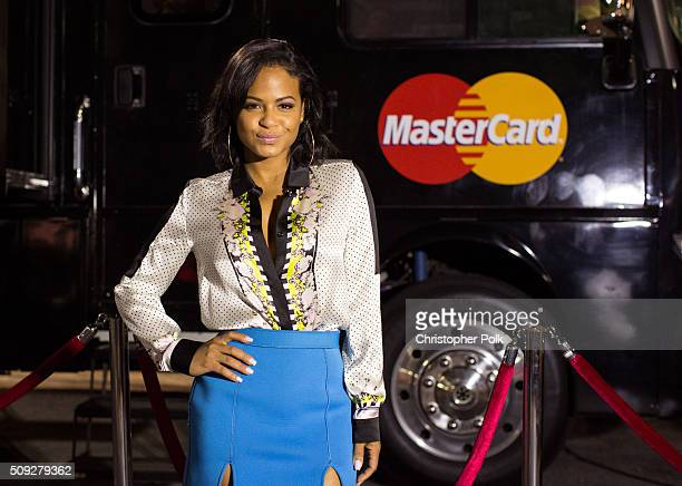 In celebration of the 58th Annual GRAMMY Awards Christina Milian surprises consumers at the MasterCard Rock the Red Carpet Truck where MasterCard...