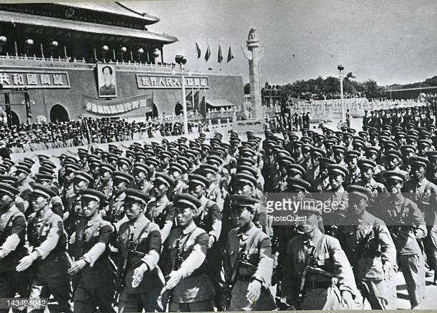 In celebration of the first anniversary of the Communist Chinese government a parade of the Red Chinese army passes in review before the dais where...