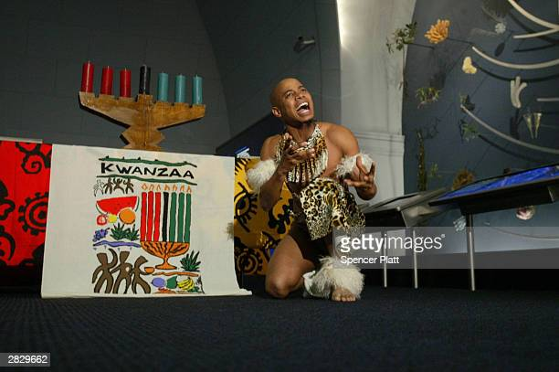 In celebration of the Kwanzaa holiday Sduduzo Ka Mbili performes a traditional Zulu warrior dance December 23 2003 at the Museum of Natural History...