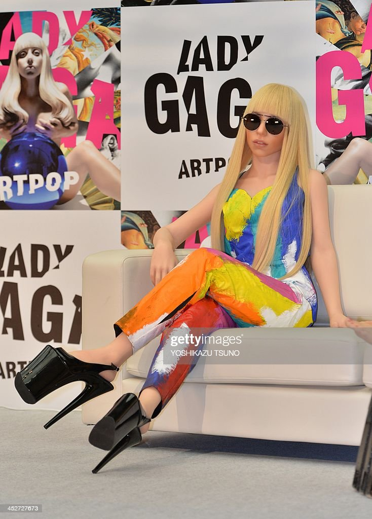 In colorful jumpsuit, US pop music star Lady Gaga look-alike doll, called Gagadoll made of silicon is displayed at a press conference in Tokyo on December 1, 2013. Lady Gaga is here for the promotion of her latest album 'ARTPOP'. AFP PHOTO / Yoshikazu TSUNO