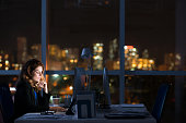 Pretty business woman working alone in dark office