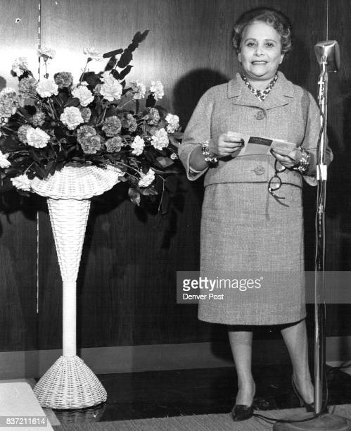 In Denver for the first time Adele Simpson famous New York Couturier posed in the Forecast shop beside a basket of Colorado carnations which inspired...