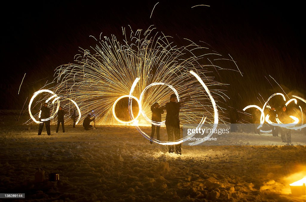 In driving snow torches representing the return of the sun are used in a symbolic battle against winter on February 4, 2012 in Huddersfield, England. Imbolc is a pagan festival that marks the half way point between the winter solstice and the spring equinox.Imbolc festivals celebrates the awakening of the land and the growing power of the Sun.