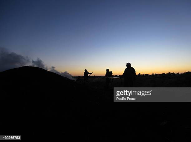 In East Gaza City the Palestinian charcoal workers spray water to the burning firewood as one of the processes in making charcoal Charcoal making...