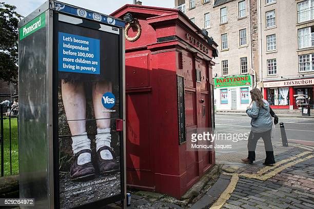 In Edinburgh a phone booth is plastered with a campaign for YES the group advocating for Scottish Independance on June 13th 2014 Views and snapshots...