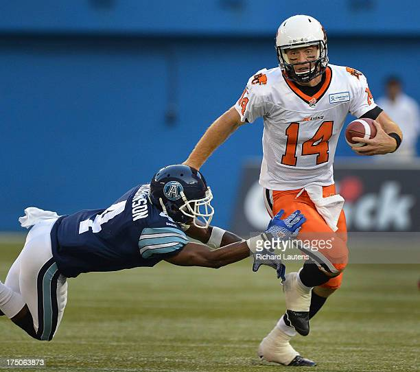 TORONTO ON JULY 30 In first half action BC QB Travis Lulay runs away from Argos DB Jamie Robinson The Toronto Argonauts took on the BC Lions at the...