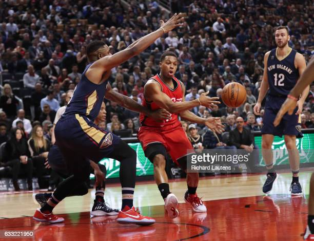 TORONTO ON JANUARY 31 In first half action Toronto Raptors guard Kyle Lowry shovels off a pass around New Orleans Pelicans forward Terrence Jones The...