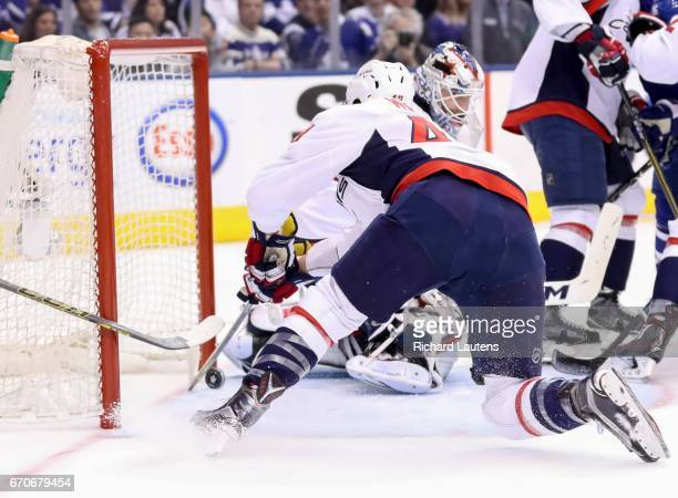 TORONTO ON APRIL 19 In first period action Washington Capitals right wing Tom Wilson just manages to keep a Leafs shot out of the net The Toronto...
