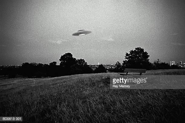 UFO in flight above urban park (Digital Composite)