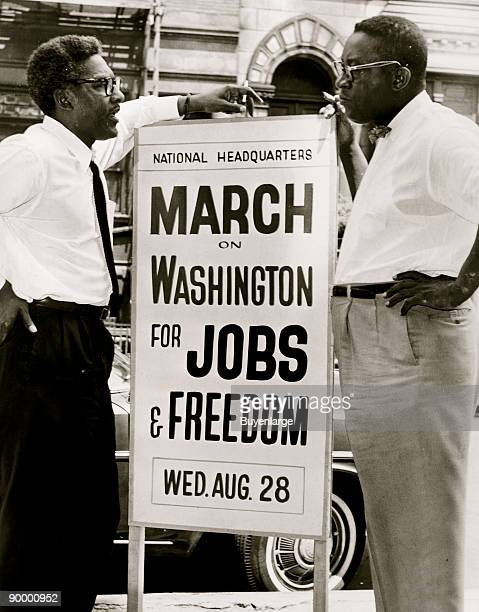 In front of 170 W 130 St March on Washington l to] r Bayard Rustin Deputy Director Cleveland Robinson Chairman of Administrative Committee